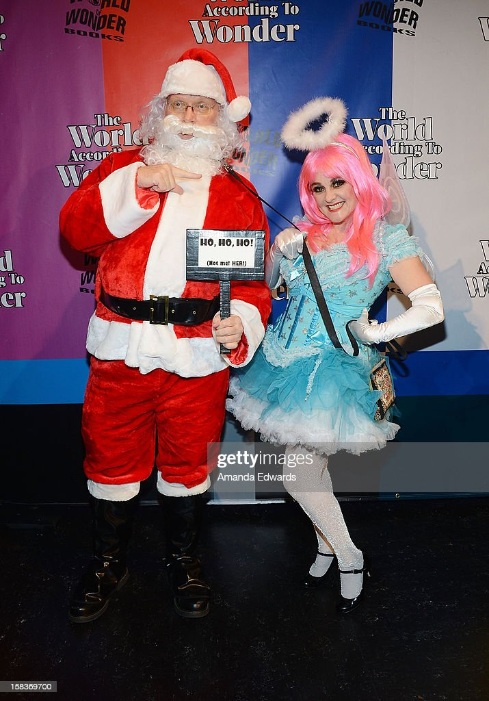 Actress and former MTV VJ Uptown Julie Brown (R) and Santa Claus arrive at the World Of Wonder book release party/birthday bash at The Globe Theatre at Universal Studios on December 13, 2012 in Universal City, California.