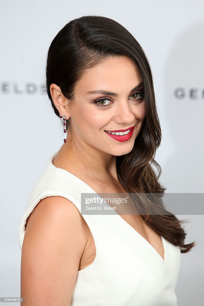 Actress and Gemfields brand ambassador, <a gi-track='captionPersonalityLinkClicked' href=/galleries/search?phrase=Mila+Kunis&family=editorial&specificpeople=212845 ng-click='$event.stopPropagation()'>Mila Kunis</a>, attends a photocall for the launch of Gemfields Mozambican rubies in London at Corinthia Hotel London on June 23, 2015 in London, England.