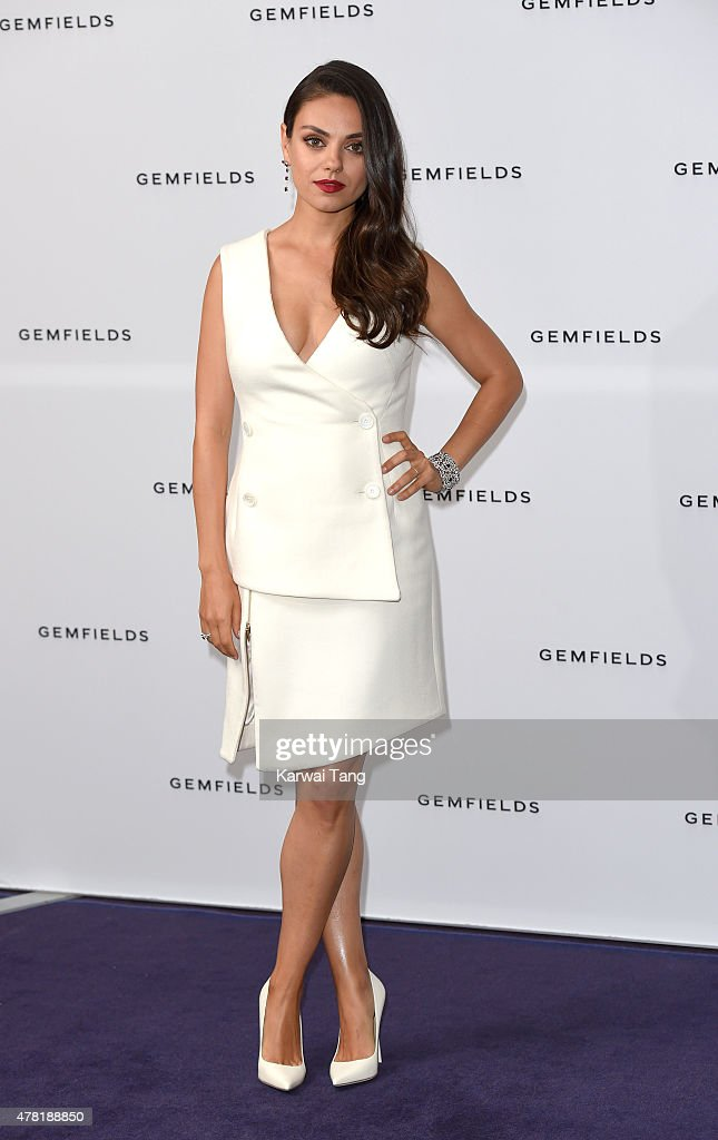 Actress and Gemfields brand ambassador, Mila Kunis, attends a photocall for the launch of Gemfields Mozambican rubies in London at Corinthia Hotel London on June 23, 2015 in London, England. Mila steps out in two pieces from Faberge's Devotion collection, including a pair of earrings set with diamonds and 10 oval Mozambican rubies totalling 9.32 carats and a ring set with diamonds and a single 5 carat oval Mozambican ruby. In addition, Mila wore the Faberge Regalia diamond and ruby bracelet set with 176 Mozambican rubies totalling over 17 carats.
