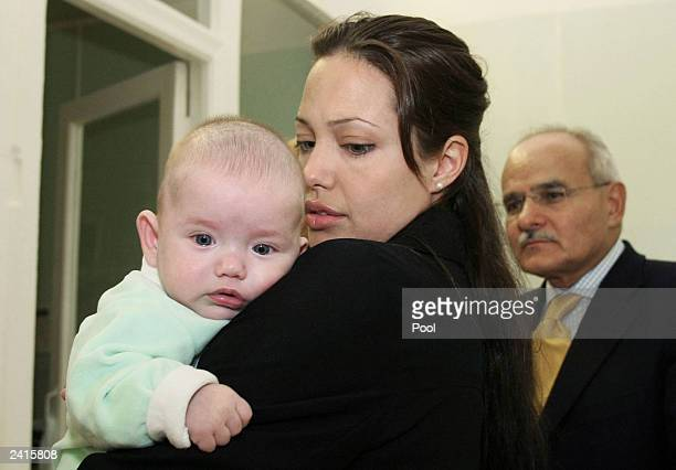 Actress and Goodwill Ambassador for the UN High Commissioner for Refugees Angelina Jolie holds a baby boy during her visit to the Morozov Children's...