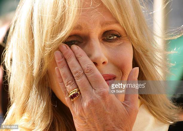 Actress and Gurkha campaigner Joanna Lumley wipes a tear from her eye as she celebrates with retired Gurkha soldiers adjacent to the Houses of...