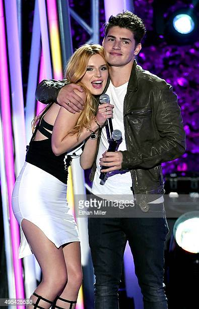 Actress and host Bella Thorne and actor Gregg Sulkin speak during the MTV Fandom Fest San Diego ComicCon at PETCO Park on July 9 2015 in San Diego...