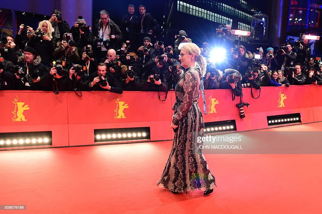 US actress and jury president Meryl Streep poses for photographers as he arrives on the red carpet for the film 'Hail, Caesar!' screening as opening film of the 66th Berlinale Film Festival in Berlin on February 11, 2016. Eighteen pictures will vie for the Golden Bear top prize at the event which runs from February 11 to 21, 2016. / AFP / John MACDOUGALL