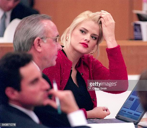 Actress and model Anna Nicole Smith looks to her attorneys in the Harris County Courtroom as the probate trial of the estate of her late husband J...