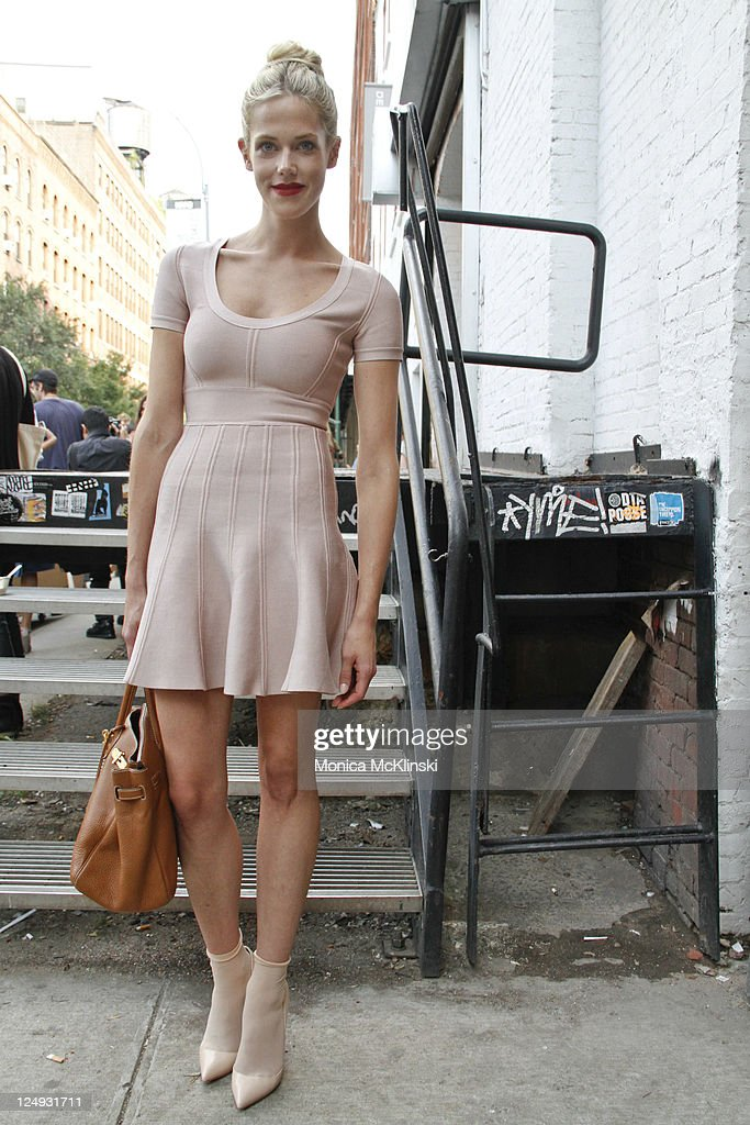 Actress and Model <a gi-track='captionPersonalityLinkClicked' href=/galleries/search?phrase=Byrdie+Bell&family=editorial&specificpeople=4062785 ng-click='$event.stopPropagation()'>Byrdie Bell</a> wearing a Herve Leger dress, Christian Louboutin shoes and Duane Reade socks departs the Theyskens' Theory Showing at Center 548 in Manhattan during Spring 2012 Fashion Week on September 13, 2011 in New York City.