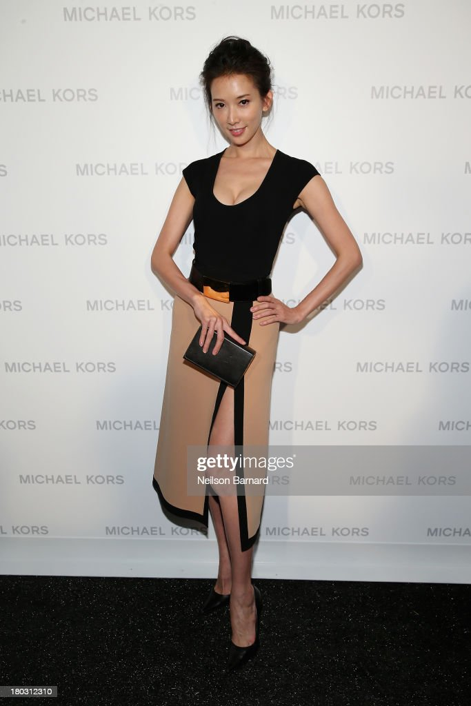 Actress and model Chi-ling Lin poses backstage at the Michael Kors fashion show during Mercedes-Benz Fashion Week Spring 2014 at The Theatre at Lincoln Center on September 11, 2013 in New York City.