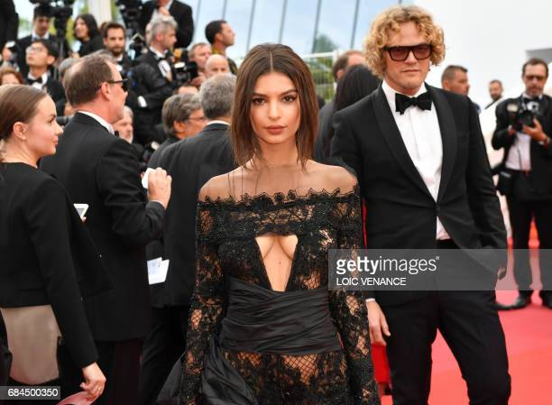 US actress and model Emily Ratajkowski and Norwegian fashion designer Peter Dundas arrives on May 18 2017 for the screening of the film 'Loveless' at...