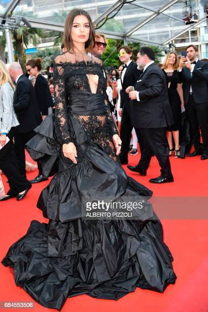 US actress and model Emily Ratajkowski poses as she arrives on May 18 2017 for the screening of the film 'Loveless' at the 70th edition of the Cannes...