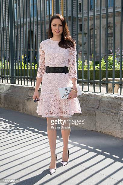Actress and Model Emma Miller is wearing a Dior dress and shoes on day 4 of Paris Collections Women on September 26 2014 in Paris France