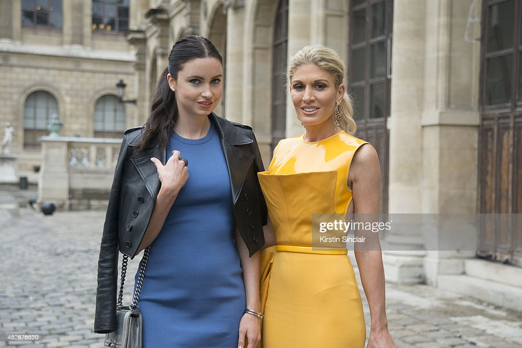 Actress and Model Emma Miller wearing a Saint Laurent jacket, Chanel bag and Balmain dress with TV presenter <a gi-track='captionPersonalityLinkClicked' href=/galleries/search?phrase=Hofit+Golan&family=editorial&specificpeople=542603 ng-click='$event.stopPropagation()'>Hofit Golan</a> wearing a Stephane Rolland dress, Bottega Veneta bag and Damiani jewellery day 5 of Paris Haute Couture Fashion Week Autumn/Winter 2014, on July 10, 2014 in Paris, France.