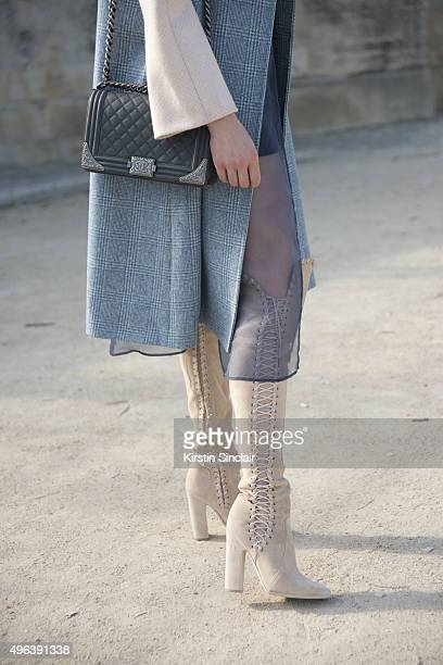 Actress and Model Emma Miller wears a Chanel bag and Prada boots and coat on day 5 during Paris Fashion Week Spring/Summer 2016/17 on October 3 2015...