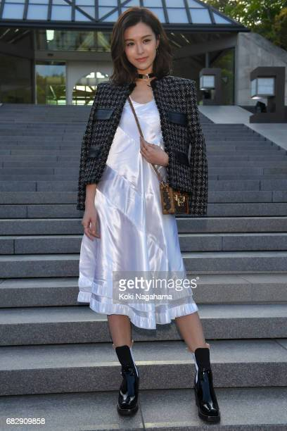 Actress and model Janice Man poses for photographs during the Louis Vuitton Resort 2018 show at the Miho Museum on May 14 2017 in Koka Japan