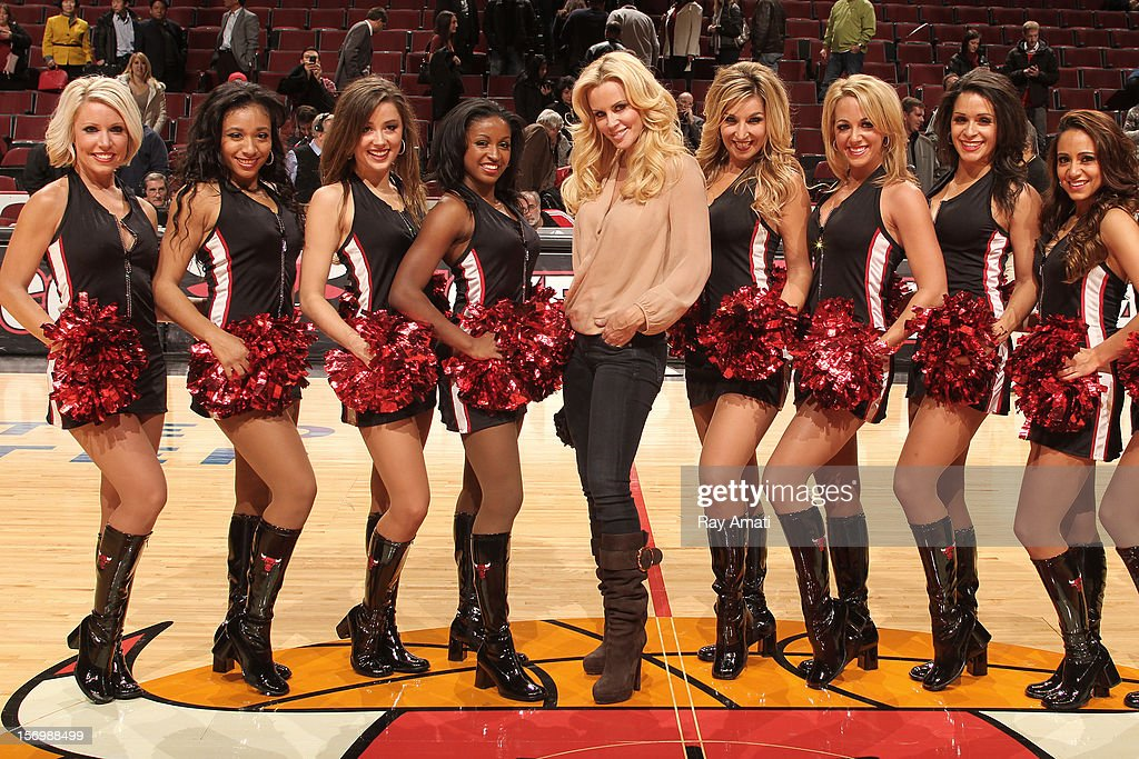 Actress and model Jenny McCarthy poses with members of the Chicago Bulls Luvabulls dance team following the game against the Milwaukee Bucks on November 26, 2012 at the United Center in Chicago, Illinois.