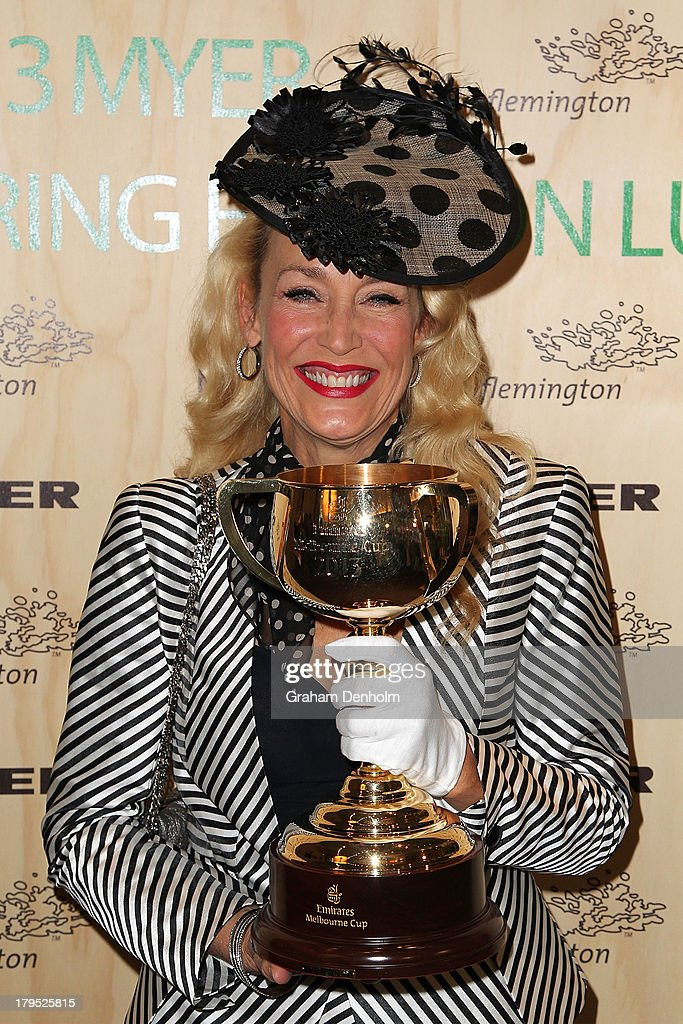 Actress and model <a gi-track='captionPersonalityLinkClicked' href=/galleries/search?phrase=Jerry+Hall&family=editorial&specificpeople=171120 ng-click='$event.stopPropagation()'>Jerry Hall</a> poses with the Melbourne Cup as she arrives at the Myer Spring Fashion Lunch at Flemington Racecourse on September 5, 2013 in Melbourne, Australia.