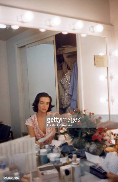 Actress and model Kitty Dolan fixes her roses while in the dressing room circa 1958 at The Tropicana Hotel in Las Vegas Nevada