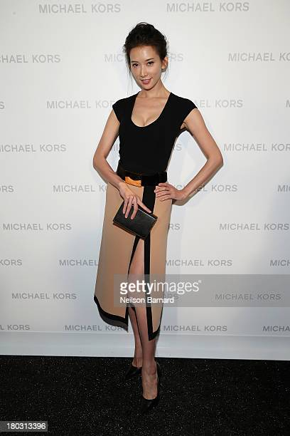 Actress and model Lin Chiling poses backstage at the Michael Kors fashion show during MercedesBenz Fashion Week Spring 2014 at The Theatre at Lincoln...
