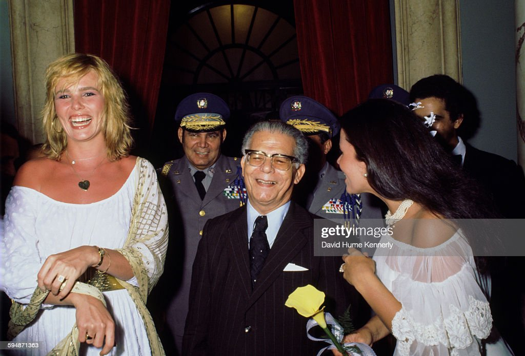 Actress and model <a gi-track='captionPersonalityLinkClicked' href=/galleries/search?phrase=Margaux+Hemingway&family=editorial&specificpeople=218193 ng-click='$event.stopPropagation()'>Margaux Hemingway</a> (L), President of the Dominican Republic, Joaquín Balaguer (C), and an unidentified person laugh at a wedding circa 1977 in Santo Domingo, Dominican Republic.