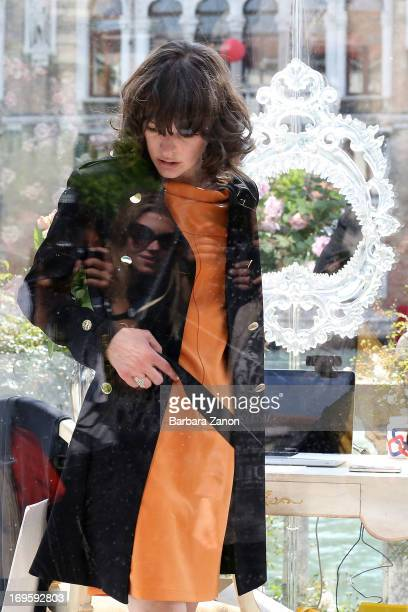 Actress and model Milla Jovovich performs on stage inside a plexiglass cube for Marella during the opening of The 55th International Art Exhibition...