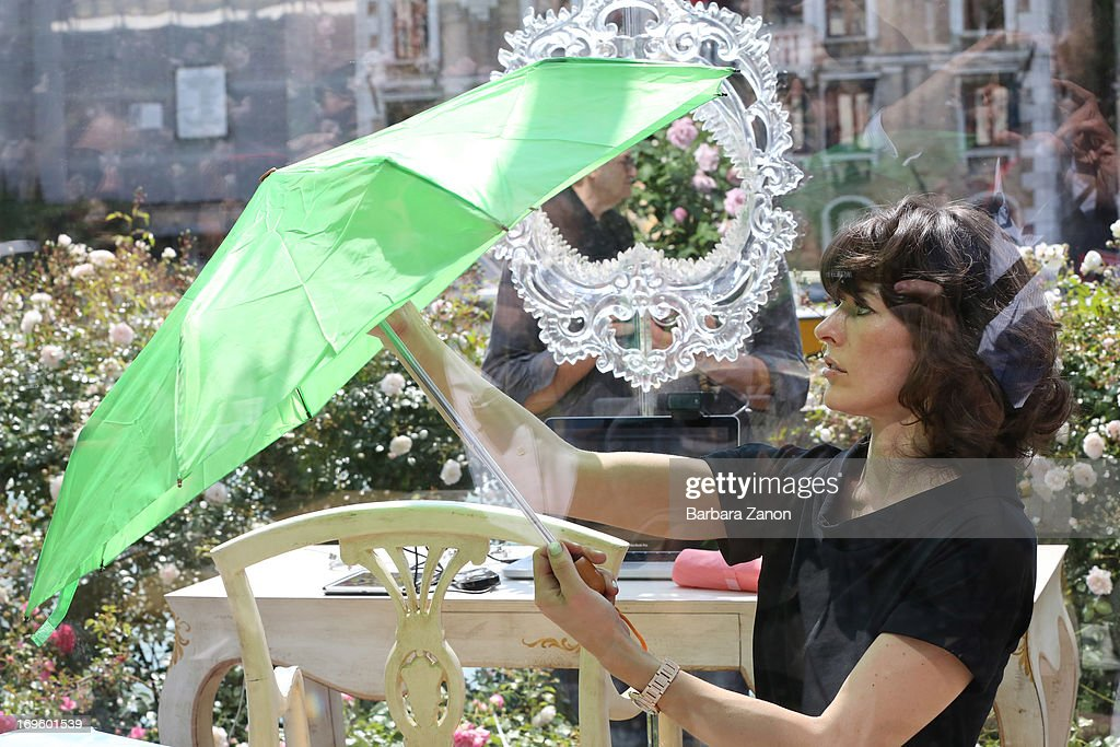 Actress and model <a gi-track='captionPersonalityLinkClicked' href=/galleries/search?phrase=Milla+Jovovich&family=editorial&specificpeople=202207 ng-click='$event.stopPropagation()'>Milla Jovovich</a> performs on stage inside a plexiglass cube for Marella during the opening of The 55th International Art Exhibition on May 28, 2013 in Venice, Italy.