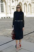 US actress and model Olivia Palermo poses upon arrival prior to the start of the Christian Dior 2015 Spring/Summer readytowear collection fashion...