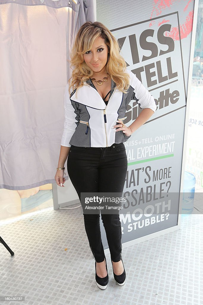 Actress and musician Adrienne Bailon gets the sparks flying at Gillette's Kiss & Tell Live National Experiment in Miami by asking women which kiss is best: a kiss with stubble or smooth shaven skin at University of Miami on January 31, 2013 in Miami, Florida.