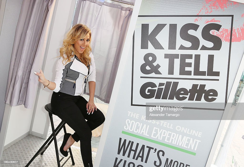 Actress and musician <a gi-track='captionPersonalityLinkClicked' href=/galleries/search?phrase=Adrienne+Bailon&family=editorial&specificpeople=540286 ng-click='$event.stopPropagation()'>Adrienne Bailon</a> gets the sparks flying at Gillette's Kiss & Tell Live National Experiment in Miami by asking women which kiss is best: a kiss with stubble or smooth shaven skin at University of Miami on January 31, 2013 in Miami, Florida.