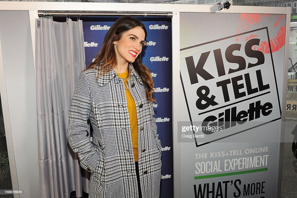 Actress and musician <a gi-track='captionPersonalityLinkClicked' href=/galleries/search?phrase=Nikki+Reed&family=editorial&specificpeople=220844 ng-click='$event.stopPropagation()'>Nikki Reed</a> helps kick off Gillette's 15-city Kiss & Tell Live National Experiment today in Times Square by asking women which kiss is best: a kiss with stubble or smooth shaven skin, on January 16, 2013 in New York City.