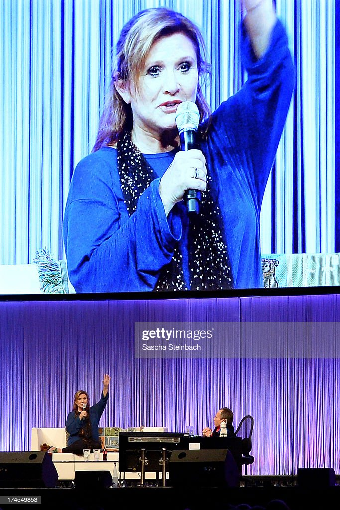 Actress and novelist <a gi-track='captionPersonalityLinkClicked' href=/galleries/search?phrase=Carrie+Fisher&family=editorial&specificpeople=209183 ng-click='$event.stopPropagation()'>Carrie Fisher</a> (L), best known for her performance as Princess Leia in the original Star Wars trilogy, and actor <a gi-track='captionPersonalityLinkClicked' href=/galleries/search?phrase=Warwick+Davis&family=editorial&specificpeople=1182415 ng-click='$event.stopPropagation()'>Warwick Davis</a> (R) attend the Star Wars Celebration at Messe Essen on July 27, 2013 in Essen, Germany.
