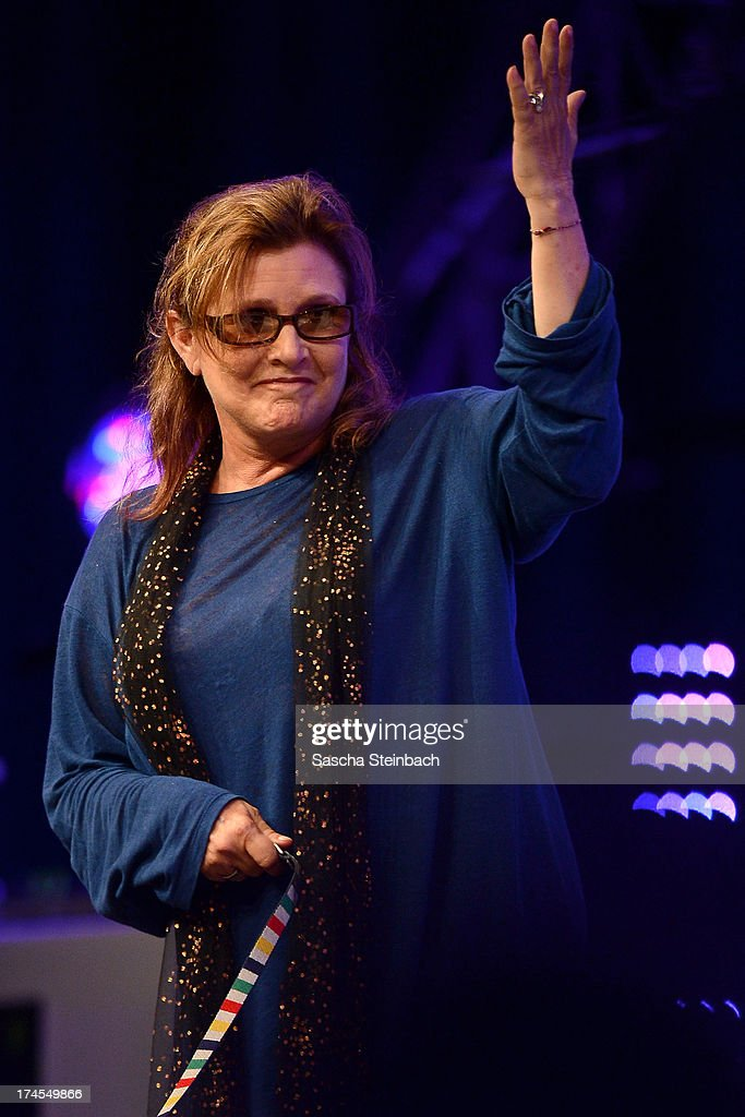 Actress and novelist <a gi-track='captionPersonalityLinkClicked' href=/galleries/search?phrase=Carrie+Fisher&family=editorial&specificpeople=209183 ng-click='$event.stopPropagation()'>Carrie Fisher</a>, best known for her performance as Princess Leia in the original Star Wars trilogy, gestures during the Star Wars Celebration at Messe Essen on July 27, 2013 in Essen, Germany.