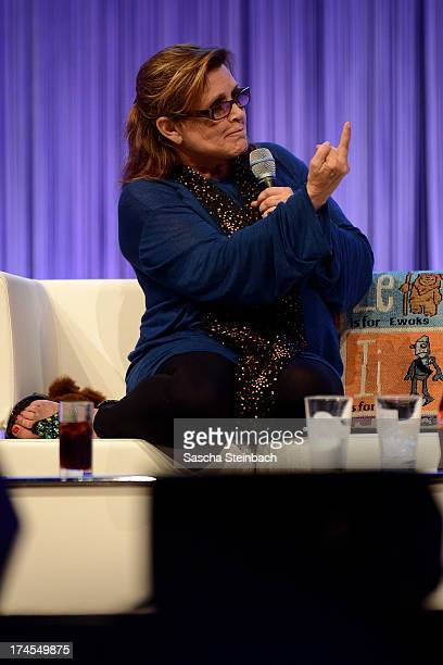 Actress and novelist Carrie Fisher best known for her performance as Princess Leia in the original Star Wars trilogy gestures during the Star Wars...