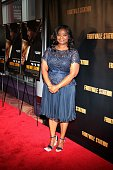 Actress and Oscar winner Octavia Spencer poses for photos during the red carpet arrivals for the 'Fruitvale Station' movie screening at the Showplace...