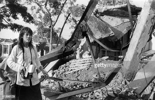 US actress and peace activist Jane Fonda holding a camera visits 25 July 1972 a Hanoi site bombed by US airplanes Fonda's trip to North Vietnam was...