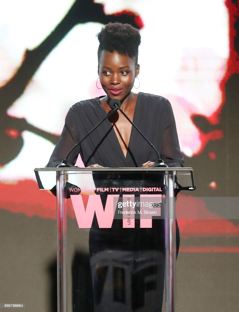 Actress and presenter Lupita Nyong'o, wearing Max Mara, speaks onstage at Women In Film 2017 Crystal + Lucy Awards presented By Max Mara and BMW at The Beverly Hilton Hotel on June 13, 2017 in Beverly Hills, California.