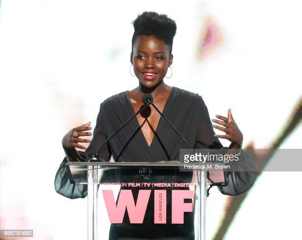Actress and presenter Lupita Nyong'o wearing Max Mara speaks onstage at Women In Film 2017 Crystal Lucy Awards presented By Max Mara and BMW at The...