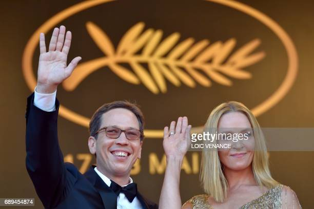 US actress and President of the Un Certain Regard jury Uma Thurman and French actor and member of the Un Certain Regard jury Reda Kateb wave as they...