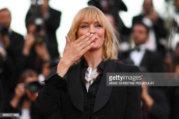 TOPSHOT US actress and President of the Un Certain Regard jury Uma Thurman blows kisses as she arrives on May 27 2017 for the Un Certain Regard prize...