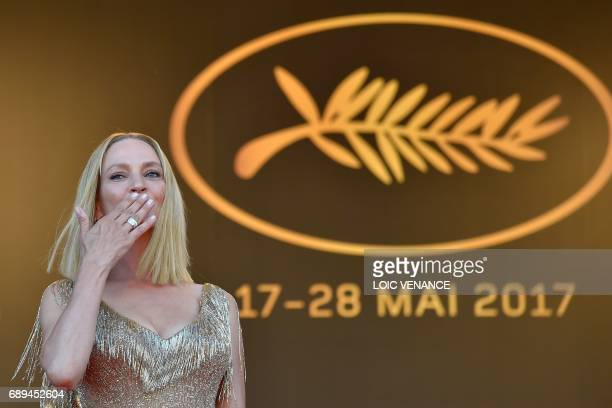 US actress and President of the Un Certain Regard jury Uma Thurman blows kisses as she arrives on May 28 2017 for the closing ceremony of the 70th...