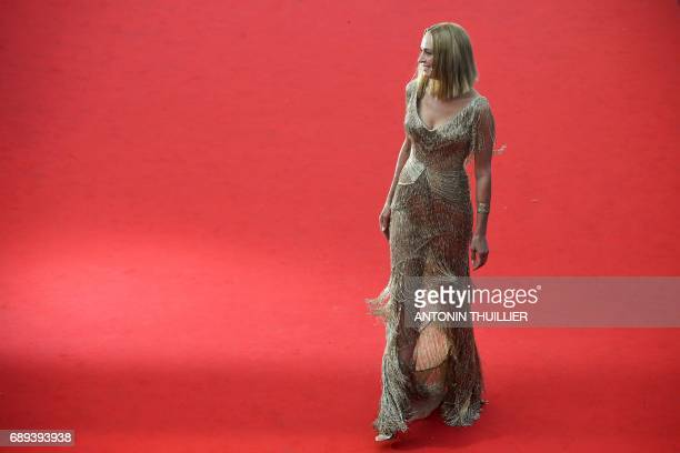 TOPSHOT US actress and President of the Un Certain Regard jury Uma Thurman poses as she arrives on May 28 2017 for the closing ceremony of the 70th...