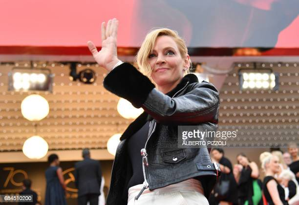 US actress and President of the Un Certain Regard jury Uma Thurman waves as she arrives on May 18 2017 for the screening of the film 'Barbara' at the...