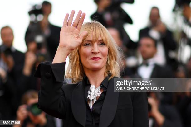 US actress and President of the Un Certain Regard jury Uma Thurman waves as she arrives on May 27 2017 for the Un Certain Regard prize ceremony at...