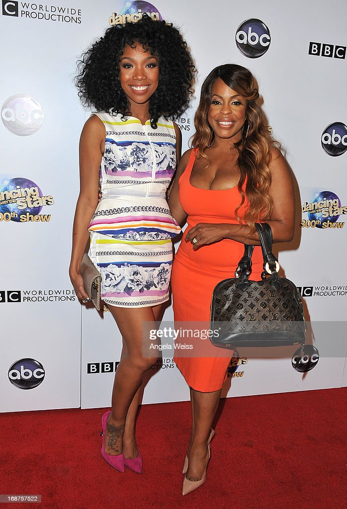 Actress and R&B Singer Brandy and <a gi-track='captionPersonalityLinkClicked' href=/galleries/search?phrase=Niecy+Nash&family=editorial&specificpeople=228464 ng-click='$event.stopPropagation()'>Niecy Nash</a> arrive at ABC's 'Dancing With The Stars' 300th Episode Celebration at Boulevard3 on May 14, 2013 in Hollywood, California.