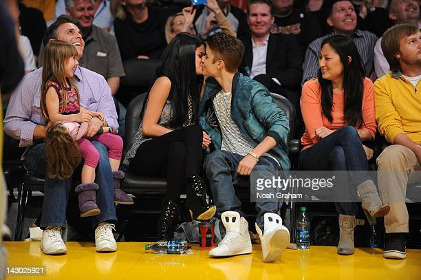 Actress and recording artist Selena Gomez and boyfriend Justin Bieber share a kiss during a game between the San Antonio Spurs and the Los Angeles...