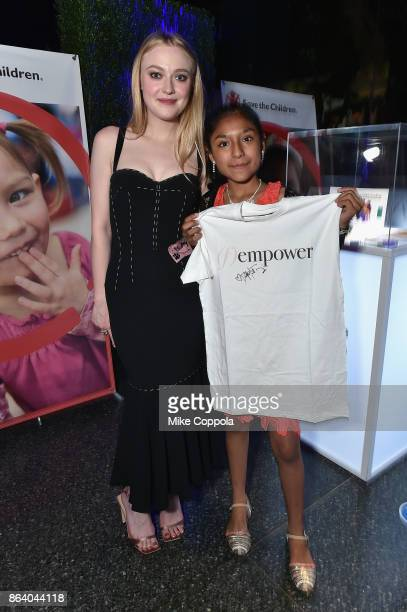 Actress and Save the Children Ambassador Dakota Fanning and Save the Children beneficiary Nicole attend the 5th Annual Save the Children Illumination...