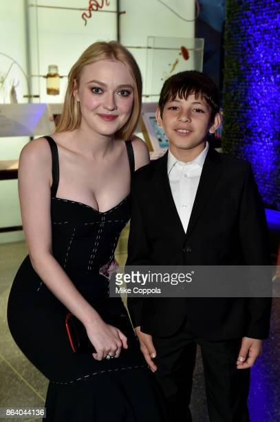 Actress and Save the Children Ambassador Dakota Fanning and Syrian refugee and Save the Children beneficiary Mahmoud Aloqla attend the 5th Annual...
