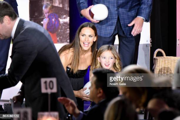 Actress and Save the Children Trustee Jennifer Garner and Save the Children beneficiary Anna Marie help raise money onstage at the 5th Annual Save...