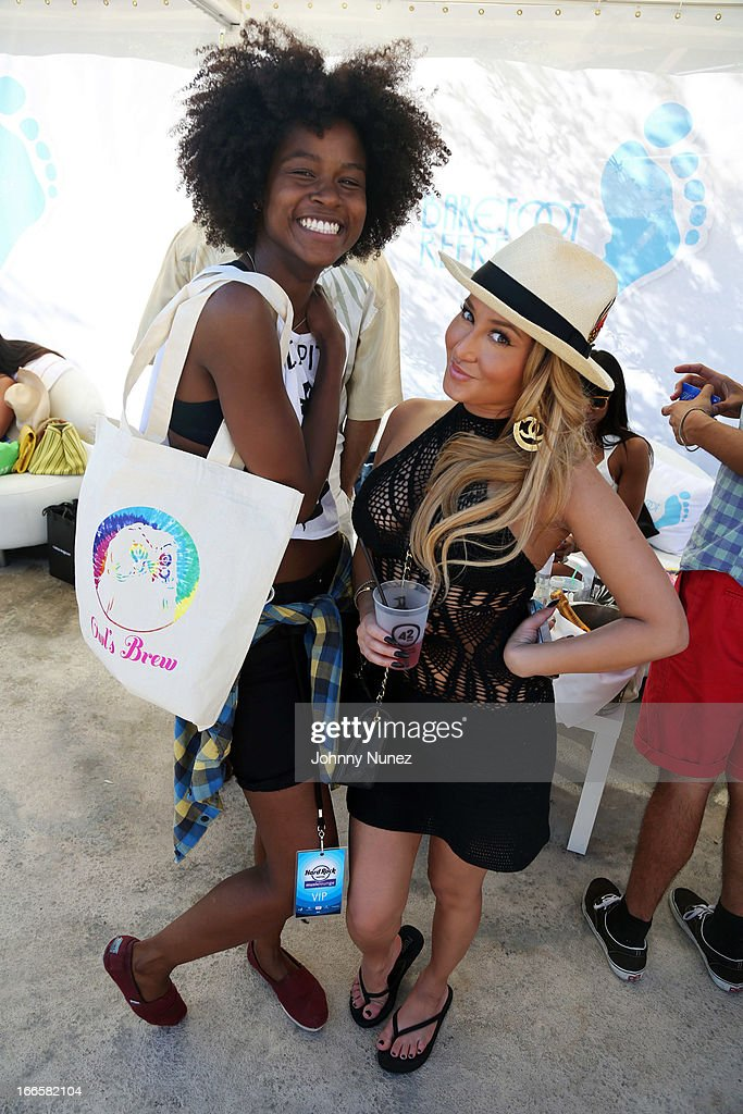 Actress and singer <a gi-track='captionPersonalityLinkClicked' href=/galleries/search?phrase=Adrienne+Bailon&family=editorial&specificpeople=540286 ng-click='$event.stopPropagation()'>Adrienne Bailon</a> (r) attend the Women Who Rock event hosted by Kelly Rowland at day 2 of the Hard Rock Music Lounge at Hard Rock Hotel Palm Springs, on April 13, 2013, in Palm Springs, California.