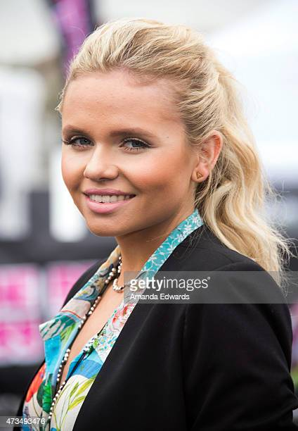 Actress and singer Alli Simpson arrives at the Nintendo 'Splatoon' launch party at Santa Monica Pier on May 15 2015 in Santa Monica California