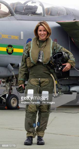 Actress and singer Claire Sweeney climbs into a Tornado GR4 of No IX squadron at RAF Marham in Norfolk before flying to RAF Fairford in Gloucester to...