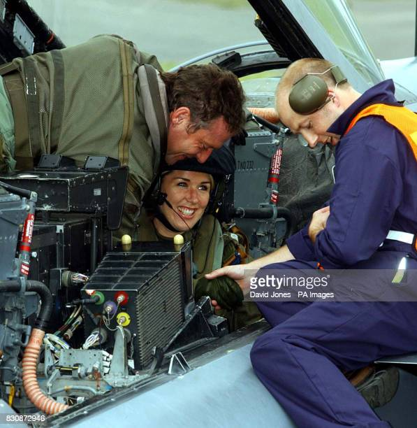 Actress and singer Claire Sweeney is unstrapped from her seat in a Tornado GR4 of No IX squadron from RAF Marham in Norfolk after flying to RAF...