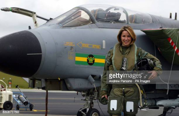 Actress and singer Claire Sweeney stands next to a Tornado GR4 of No IX squadron from RAF Marham in Norfolk before flying To RAF Fairford in...